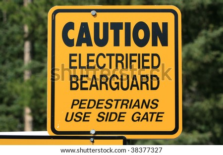 A sign on an electric fence in Lake Louise campground, Alberta, Canada.