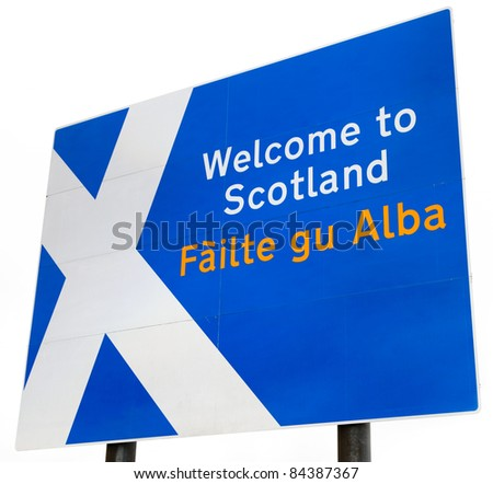 "A sign on the border crossing to Scotland from England.  Contains the Scottish flag and ""Welcome to Scotland"" in English and Gaelic.  Isolated on a white background. - stock photo"