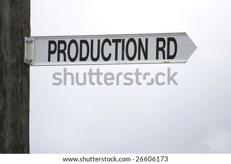 A sign pointing right posted as production road