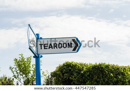 A sign pointing the way to the tearoom, UK - stock photo