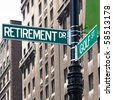 A sign post at the intersection of two streets reading RETIREMENT DR and GOLF ST.  Remove the words and insert your own to easily customize the message. - stock photo