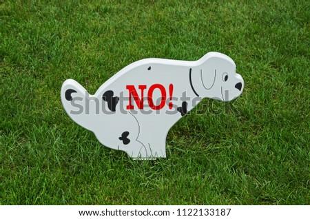 stock-photo-a-sign-prohibiting-walking-o