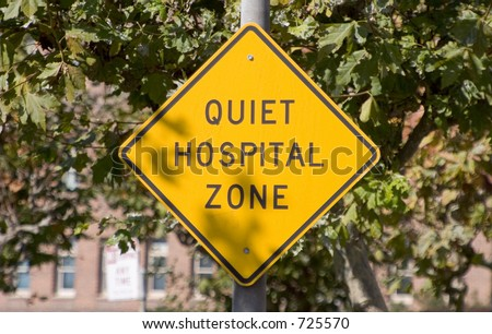 "A sign reading ""Quiet Hospital Zone"" gives warning."