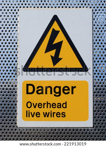 A sign showing danger overhead wires  / Danger sign - stock photo