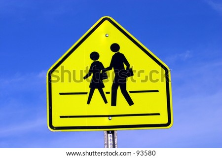 A sign states that this is a pedestrian crossing. - stock photo