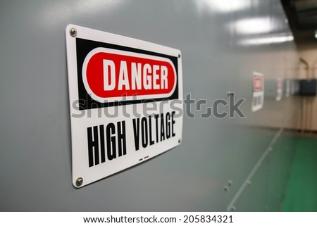 A sign stating of a high voltage danger - stock photo