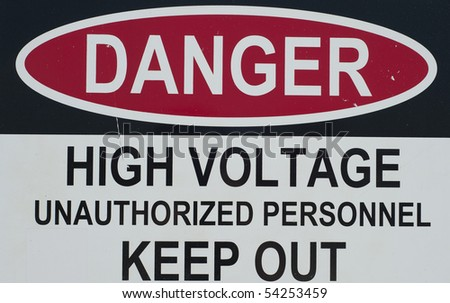 a sign stating of a high voltage danger and to keep out - stock photo