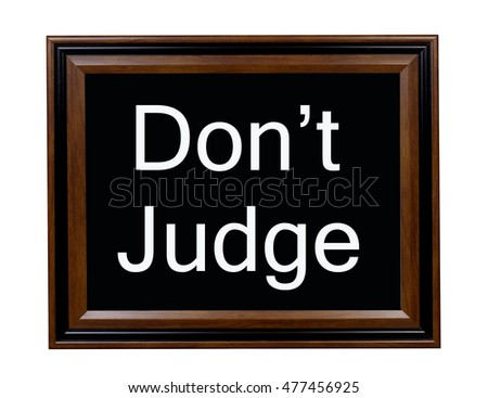 A sign telling everyone not to judge other people