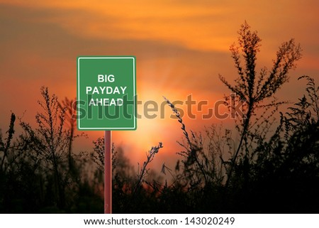 A sign warning a Big payday ahead. - stock photo