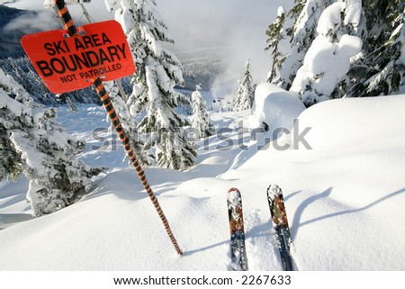 A sign warns of danger ahead, but how can one resist such temptation? - stock photo
