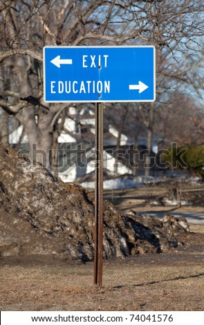 "A sign with the words ""education"" and ""exit"" with arrows pointing in opposite directions. Could symbolize choice between education and dropping out of school. - stock photo"