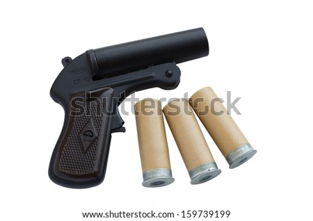 A signal pistol and cartridges on a white background