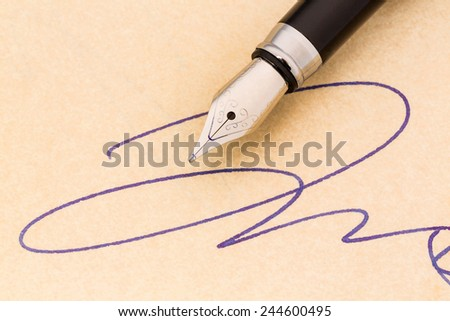 a signature and a fountain pen on yellow paper. symbolic photo for contract, testament and graphology