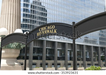 A signboard infront of Chicago Riverwalk, which is a pedestrian Chicago river waterfront on the South banks of the river. On the background, Trump International Tower is seen.