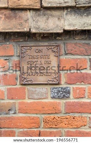 A signpost on a wall saying that Nothing Happened here back in 1782 - stock photo
