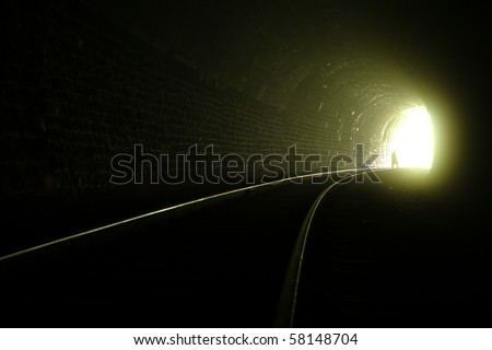A silhouette near the exit from railroad tunnel - stock photo