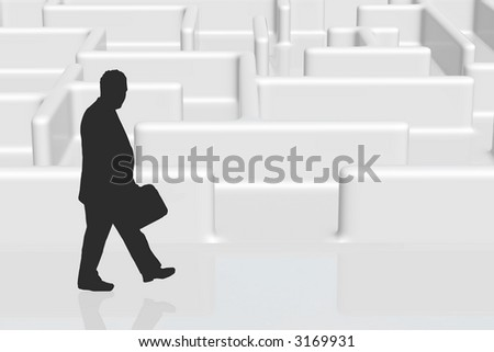 A silhouette of a businessman entering a maze - stock photo