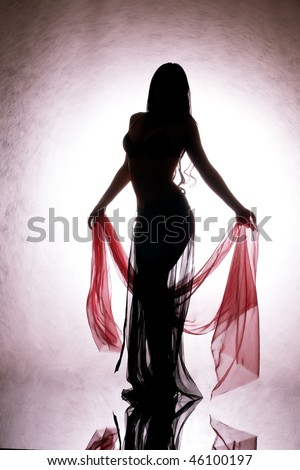 A silhouette of a dancing woman with a red silk in your hand. - stock photo