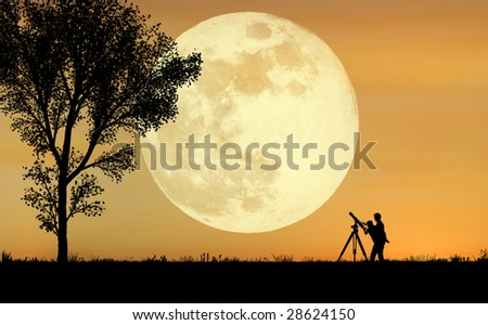 A silhouette of a father holding his child up to a telescope with a full moon in the background - stock photo