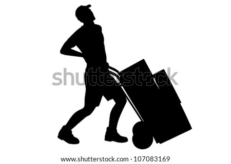 A silhouette of a full length portrait of a delivery boy, suffering from a back pain, pushing a hand truck isolated on white background - stock photo