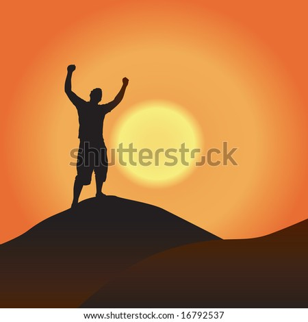 A silhouette of a man atop a mountain with his arms raised up in the air. - stock photo