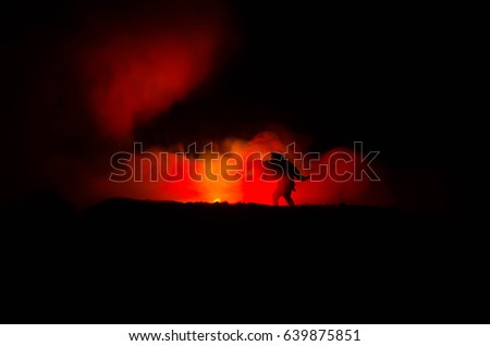 a silhouette of a man holding on to the woman. Rescue saviour concept. Escape from fire or danger. Surreal decoration