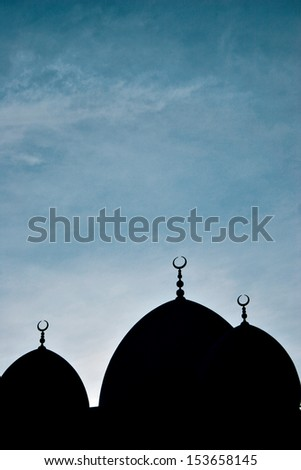A silhouette of a mosque in Dubai. - stock photo