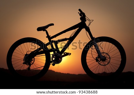 A silhouette of a mountain bike - stock photo