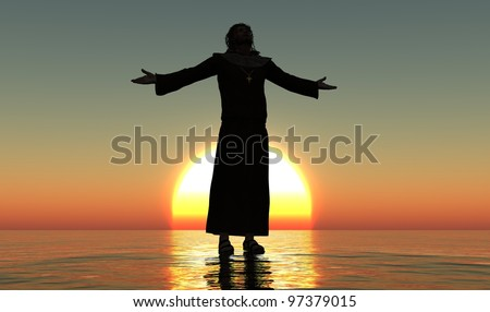 A silhouette of a priest in a landscape. - stock photo
