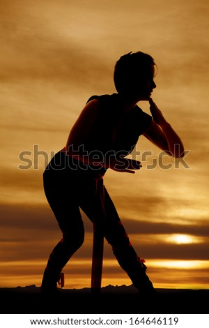 A silhouette of a woman ninja ready to fight. - stock photo