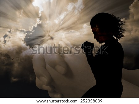 A silhouette of a woman to God - stock photo