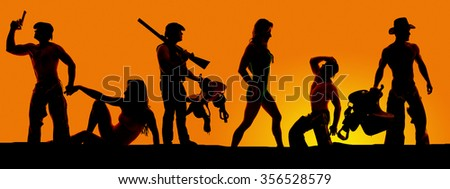 a silhouette of cowboys with his women in a row, with guns and saddle. - stock photo