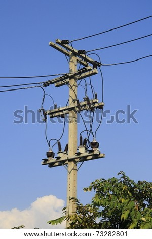 A silhouette of low voltage power lines against - stock photo