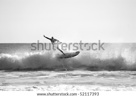A Silhouette of Surfer in the Ocean - stock photo