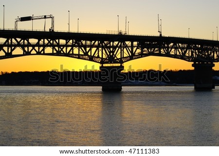 A silhouetted bridge at sunset on the york river in virginia