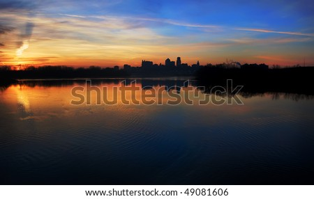 A silhouetted panoramic view of the Kansas City skyline which is located in the Great Plains area in the United States.