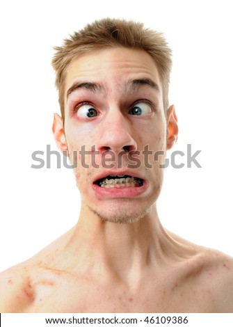 A silly white male isolated on white background with his throat tenses up with his eyes crossed. - stock photo