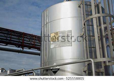 A silo of caustic soda stores chemicals for cleaning at a milk factory