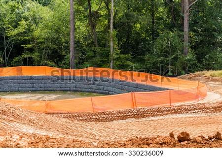 A Silt Fence Around a Retention Pond - stock photo