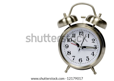 A silver alarm clock isolated on white with the face being the main focus. - stock photo