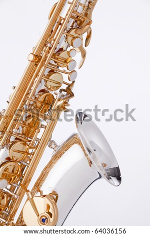 A silver and gold saxophone isolated against a white background.