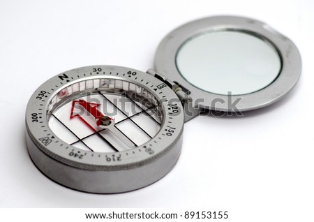 A silver and red Compass on a white background - stock photo