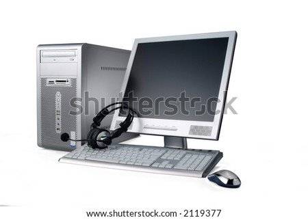 a silver case computer,with lcd monitor, keyboard, phones and mouse, isolated over white. Has clipping path
