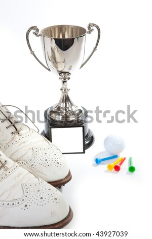 A silver cup  and golf shoes with white space on cup for copy - stock photo