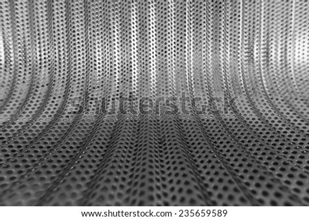 A silver metallic texture background pattern with lines and stripes - stock photo