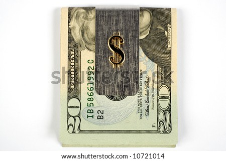 A Silver money clip with 20 dollar bill showing. Clip has a golden money sign on it. - stock photo