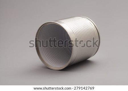 A silver tin can isolated on a gray background - stock photo