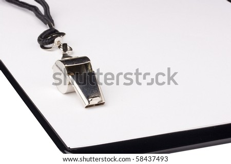 A silver whistle with a black string laying on a clipboard with white paper. Add your text to the background. - stock photo