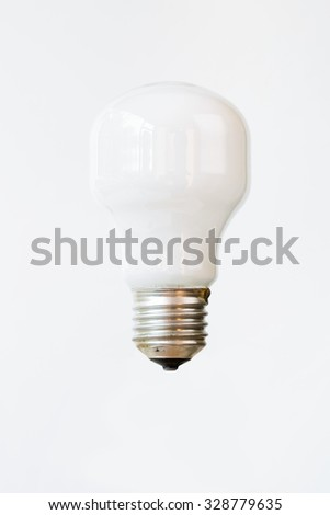 A simple and elegant light bulb against a basic, vertical, white background.