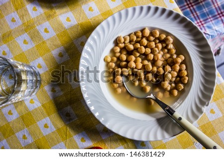 a simple ang genuine chickpeas dish on a rustic table